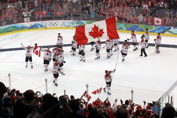 VANCOUVER, BC - FEBRUARY 28:  Sidney Crosby #87 of Canada skates with the Canadian national flag following Canada's 3-2 overtime victory during the ice hockey men's gold medal game between USA and Canada on day 17 of the Vancouver 2010 Winter Olympics at