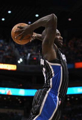 PHOENIX, AZ - MARCH 13:  Jason Richardson #23 of the Orlando Magic slam dunks the ball against the Phoenix Suns during the NBA game at US Airways Center on March 13, 2011 in Phoenix, Arizona.  NOTE TO USER: User expressly acknowledges and agrees that, by