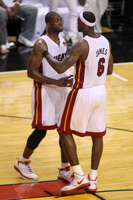 MIAMI, FL - MAY 31:  LeBron James #6 and Dwyane Wade #3 of the Miami Heat hug after the Heat defeat the Dallas Mavericks 92-84 in Game One of the 2011 NBA Finals at American Airlines Arena on May 31, 2011 in Miami, Florida. NOTE TO USER: User expressly ac