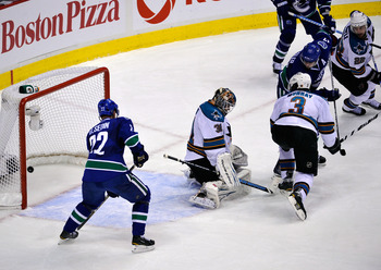 VANCOUVER, CANADA - MAY 24:   Ryan Kesler #17 of the Vancouver Canucks deflects the puck into the net for a goal to tie the game at 2-2 with less than 14 seconds left in the third period past goaltender Antti Niemi #31 of the San Jose Sharks in Game Five