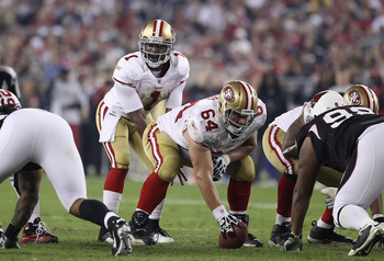 GLENDALE, AZ - NOVEMBER 29:  Center David Baas #64 of the San Francisco 49ers prepares to snap the football to Troy Smith #1 during the NFL game against the Arizona Cardinals at the University of Phoenix Stadium on November 29, 2010 in Glendale, Arizona.