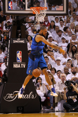 MIAMI, FL - MAY 31:  Tyson Chandler #6 of the Dallas Mavericks reacts after he dunked against the Miami Heat in Game One of the 2011 NBA Finals at American Airlines Arena on May 31, 2011 in Miami, Florida. NOTE TO USER: User expressly acknowledges and agr