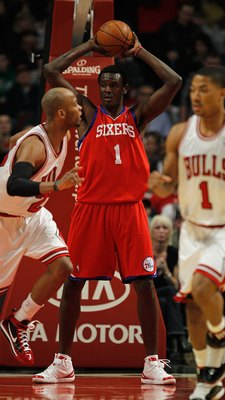 CHICAGO - FEBRUARY 20: Samuel Dalembert #1 of the Philadelphia 76ers looks to pass after grabbing a rebound against the Chicago Bulls at the United Center on February 20, 2010 in Chicago, Illinois. The Bulls defeated the 76ers 122-90. NOTE TO USER: User e