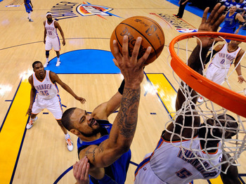 OKLAHOMA CITY, OK - MAY 21:  Tyson Chandler #6 of the Dallas Mavericks goes up for a shot over Kendrick Perkins #5 of the Oklahoma City Thunder in the first half in Game Three of the Western Conference Finals during the 2011 NBA Playoffs at Oklahoma City