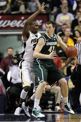 INDIANAPOLIS, IN - MARCH 11:  Garrick Sherman #41 of the Michigan State Spartans looks to pass against JaJuan Johnson #25 of the Purdue Boilermakers during the quarterfinals of the 2011 Big Ten Men's Basketball Tournament at Conseco Fieldhouse on March 11