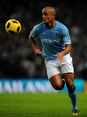 MANCHESTER, ENGLAND - DECEMBER 04:   Vincent Kompany of Manchester City in action during the Barclays Premier League match between Manchester City and Bolton Wanderers at the City of Manchester Stadium on December 4, 2010 in Manchester, England.  (Photo b