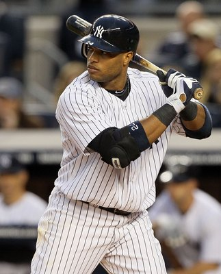 NEW YORK, NY - MAY 14:  Robinson Cano #24 of the New York Yankees bats against the Boston Red Sox on May 14, 2011 at Yankee Stadium in the Bronx borough of New York City.  (Photo by Jim McIsaac/Getty Images)