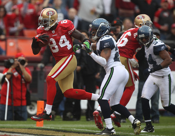 SAN FRANCISCO - DECEMBER 12:  Josh Morgan #84 of the San Francisco 49ers cacthes a touchdown against the Seattle Seahawks during an NFL game at Candlestick Park on December 12, 2010 in San Francisco, California.(Photo by Jed Jacobsohn/Getty Images)