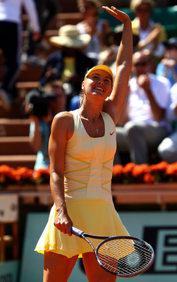 PARIS, FRANCE - JUNE 01:  Maria Sharapova of Russia celebrates matchpoint during the women's singles quarterfinal match between Maria Sharapova of Russia and Andrea Petkovic of Germany on day eleven of the French Open at Roland Garros on June 1, 2011 in P