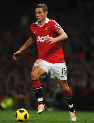 MANCHESTER, ENGLAND - NOVEMBER 20: Nemanja Vidic of Manchester United plays the ball during the Barclays Premier League match between Manchester United and Wigan Athletic at Old Trafford on November 20, 2010 in Manchester, England.  (Photo by Michael Rega