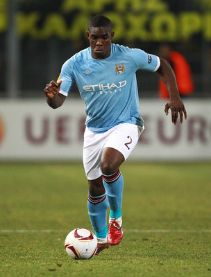 THESSALONIKI, GREECE - FEBRUARY 15:  Micah Richards of Manchester City in action during the first leg round of 32 Europa League match between Aris Saloniki and Manchester City  at Kleanthis Vikelidis stadium on February 15, 2011 in Thessaloniki, Greece.