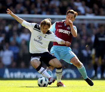 LONDON, ENGLAND - MARCH 19:  Luka Modric (L) of Tottenham Hotspur battles for the ball with Scott Parker of West Ham during the Barclays Premier League match between Tottenham Hotspur and West Ham United at White Hart Lane on March 19, 2011 in London, Eng
