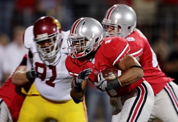 COLUMBUS, OH - SEPTEMBER 12:  Running back Daniel Herron #1 of the Ohio State Buckeyes rushes up the middle for a 2-yard gain during the first quarter of the game against of the USC Trojans at Ohio Stadium on September 12, 2009 in Columbus, Ohio. (Photo b