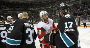 SAN JOSE, CA - MAY 12:  Henrik Zetterberg #40 of the Detroit Red Wings shakes hands with Torrey Mitchell #17 of the San Jose Sharks after Game Seven of the Western Conference Semifinals during the 2011 NHL Stanley Cup Playoffs at HP Pavilion on May 12, 20