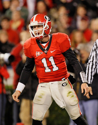 ATHENS, GA - NOVEMBER 27:  Quarterback Aaron Murray #11 of the Georgia Bulldogs reacts after tossing a touchdown pass against the Georgia Tech Yellow Jackets at Sanford Stadium on November 27, 2010 in Athens, Georgia.  (Photo by Kevin C. Cox/Getty Images)
