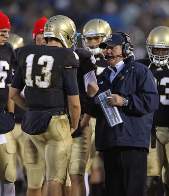 SOUTH BEND, IN - NOVEMBER 13: Head coach Brian Kelly of the Notre Dame Fighting Irish talks with Tommy Rees #13 during a game against the Utah Utes at Notre Dame Stadium on November 13, 2010 in South Bend, Indiana. Notre Dame defeated Utah 28-3. (Photo by