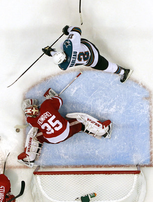 DETROIT - MAY 10: Jimmy Howard #35 of the Detroit Red Wings stops a second period shot by Patrick Marleau #12 of the San Jose Sharks in Game Six of the Western Conference Semifinals during the 2011 NHL Stanley Cup Playoffs on May 10, 2011 at Joe Louis Are