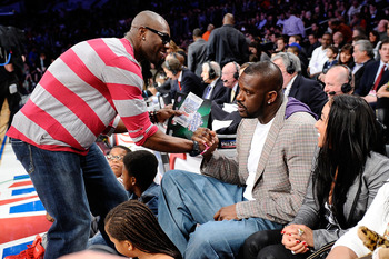 LOS ANGELES, CA - FEBRUARY 19:  NFL player Terrell Owens shakes hands with Shaquille O'Neal of the Boston Celtics as they attend NBA All-Star Saturday night presented by State Farm at Staples Center on February 19, 2011 in Los Angeles, California.  NOTE T