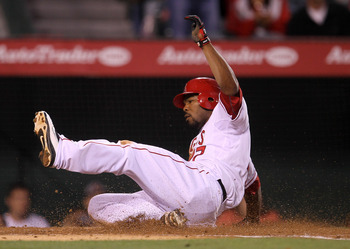 ANAHEIM, CA - MAY 10: Howie Kendrick #47 of the Los Angeles Angels of Anaheim slides home with a run in the third inning against the Chicago White Sox on May 10, 2011 at Angel Stadium in Anaheim, California.   (Photo by Stephen Dunn/Getty Images)