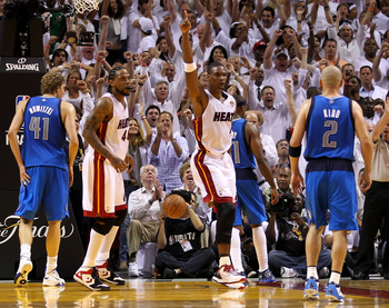 MIAMI, FL - MAY 31:  Chris Bosh #1 of the Miami Heat reacts in the fourth quarter while taking on the Dallas Mavericks in Game One of the 2011 NBA Finals at American Airlines Arena on May 31, 2011 in Miami, Florida. NOTE TO USER: User expressly acknowledg