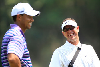 PONTE VEDRA BEACH, FL - MAY 10:  Tiger Woods (L) shares a laugh with his instructor Sean Foley (R) during a practice round prior to the start of THE PLAYERS Championship held at THE PLAYERS Stadium course at TPC Sawgrass on May 10, 2011 in Ponte Vedra Bea