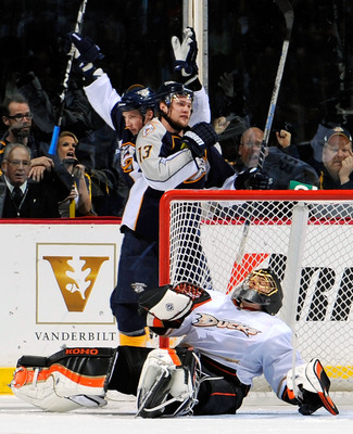 NASHVILLE, TN - MARCH 24:  Jerred Smithson #25 and Nick Spaling #13 of the Nashville Predators celebrate after scoring a goal against Jonas Hiller #1 of the Anaheim Ducks on March 24, 2011 at the Bridgestone Arena in Nashville, Tennessee.  (Photo by Frede