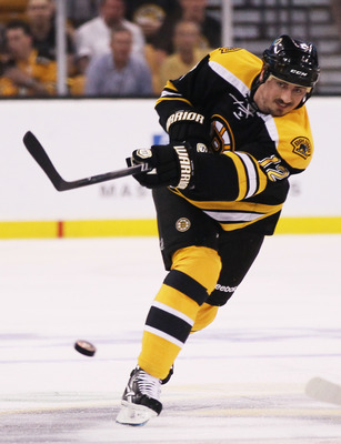BOSTON, MA - MAY 27:  Tomas Kaberle #12 of the Boston Bruins controls the puck in Game Seven of the Eastern Conference Finals against the Tampa Bay Lightning during the 2011 NHL Stanley Cup Playoffs at TD Garden on May 27, 2011 in Boston, Massachusetts.