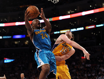 LOS ANGELES, CA - APRIL 26:  Carl Landry #24 of the New Orleans Hornets goes up for a shot against Pau Gasol #16 of the Los Angeles Lakers in the third quarter in Game Five of the Western Conference Quarterfinals in the 2011 NBA Playoffs on April 26, 2011