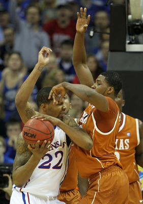 KANSAS CITY, MO - MARCH 12:  Marcus Morris #22 of the Kansas Jayhawks fights for position against Tristan Thompson #13 of the Texas Longhorns in the first half of the 2011 Phillips 66 Big 12 Men's Basketball Tournament championship game at Sprint Center o