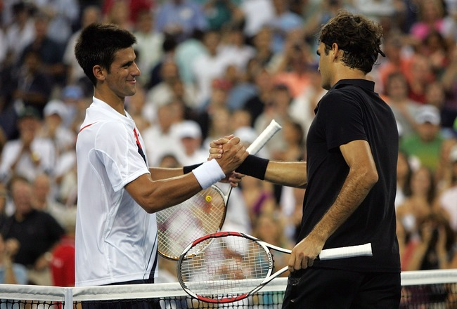 NEW YORK - SEPTEMBER 09:  Roger Federer of Switzerland greets Novak Djokovic of Serbia after defeating him by a score of 7-6(4), 7-6(2), 6-4 to win the Men's Singles Final on day fourteen of the 2007 U.S. Open in Arthur Ashe Stadium at the Billie Jean Kin