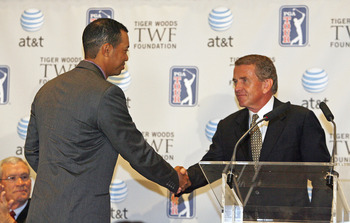 UNITED STATES - MARCH 07:  Tiger Woods shakes hands with Tim Finchem, PGA TOUR commissioner, at a press conference announcing a new PGA TOUR event called the AT&T National, at the National Press Club in Washington, D.C. on Wednesday, March 7, 2006. The PG