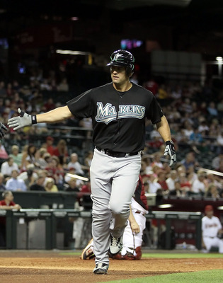 PHOENIX, AZ - MAY 31:  Gaby Sanchez #15 of the Florida Marlins high fives teammate Greg Dobbs #29 after Sanchez hit a solo home run against the Arizona Diamondbacks during the seventh inning of the Major League Baseball game at Chase Field on May 31, 2011