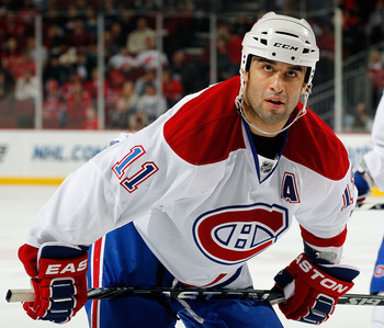 NEWARK, NJ - APRIL 02:  Scott Gomez #11 of the Montreal Canadians waits for a faceoff during an NHL hockey game against the New Jersey Devils at the Prudential Center on April 2, 2011 in Newark, New Jersey.  (Photo by Paul Bereswill/Getty Images)