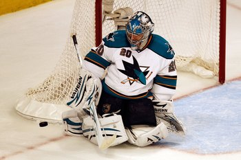 CHICAGO - MAY 23:  Goaltender Evgeni Nabokov #20 of the San Jose Sharks makes a save while taking on the Chicago Blackhawks in Game Four of the Western Conference Finals during the 2010 NHL Stanley Cup Playoffs at the United Center on May 23, 2010 in Chic