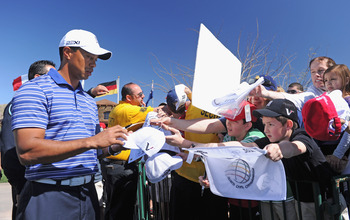 MARANA, AZ - FEBRUARY 22:  Tiger Woods signs autographs during practice prior to the start of the World Golf Championships-Accenture Match Play Championship held at The Ritz-Carlton Golf Club, Dove Mountain on February 22, 2011 in Marana, Arizona.  (Photo