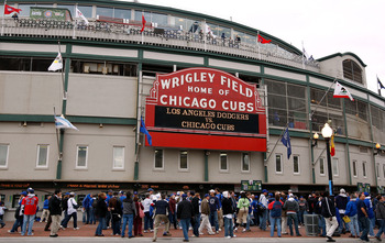 CHICAGO - OCTOBER 01:  Fans stand outside Wrigley Field under the famous marquee, which reads Los Angeles Dodgers vs. Chicago Cubs' prior to the Cubs hosting the Dodgers in Game One of the NLDS during the 2008 MLB Playoffs at Wrigley Field on October 1, 2