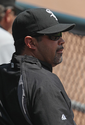 CHICAGO, IL - MAY 22:  Manager Ozzie Guillen #13 of the Chicago White Sox watches as his team takes on the Los Angeles Dodgers at U.S. Cellular Field on May 22, 2011 in Chicago, Illinois. The White Sox defeated the Dodgers 8-3.  (Photo by Jonathan Daniel/