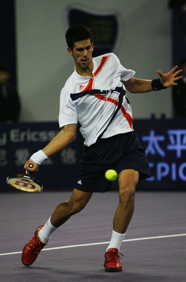 SHANGHAI, CHINA - NOVEMBER 15:  Novak Djokovic of Serbia returns a shot during his round robin match against Rafael Nadal of Spain in the Tennis Masters Cup at Qi Zhong Stadium on November 15, 2007 in Shanghai, China.  (Photo by Andrew Wong/Getty Images)
