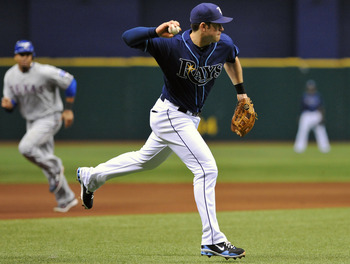 ST. PETERSBURG, FL - JUNE 1:  Third baseman Evan Longoria #3 of the Tampa Bay Rays throws to first base against the Texas Rangers June 1, 2011 at Tropicana Field in St. Petersburg, Florida.  (Photo by Al Messerschmidt/Getty Images)