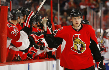 OTTAWA, CANADA - APRIL 07:  Colin Greening #52 of the Ottawa Senators celebrates a goal with teammate David Hale #36 in a game against the Montreal Canadiens at Scotiabank Place on April 7, 2011 in Ottawa, Canada.  (Photo by Phillip MacCallum/Getty Images