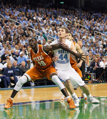 GREENSBORO, NC - DECEMBER 18:  Tyler Zeller #44 of the North Carolina Tar Heels against Alexis Wangmene #20 of the Texas Longhorns at Greensboro Coliseum on December 18, 2010 in Greensboro, North Carolina.  (Photo by Kevin C. Cox/Getty Images)