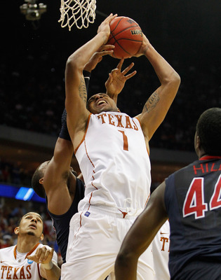 TULSA, OK - MARCH 20:  Gary Johnson #1 of the Texas Longhorns grabs a rebound in the final moments of their 70-69 loss to the Arizona Wildcats during the third round of the 2011 NCAA men's basketball tournament at BOK Center on March 20, 2011 in Tulsa, Ok