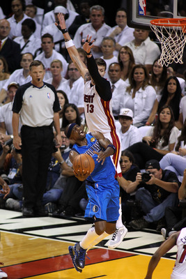 MIAMI, FL - MAY 31:  Jason Terry #31 of the Dallas Mavericks goes up for a shot against Mike Miller #13 of the Miami Heat in the first half in Game One of the 2011 NBA Finals at American Airlines Arena on May 31, 2011 in Miami, Florida. NOTE TO USER: User