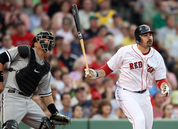 BOSTON, MA - MAY 30:  Adrian Gonzalez #28 of the Boston Red Sox and A.J. Pierzynski #12 of the Chicago White Sox watch Gonzalez's solo home run in the first inning on May 30, 2011 at Fenway Park in Boston, Massachusetts.  (Photo by Elsa/Getty Images)
