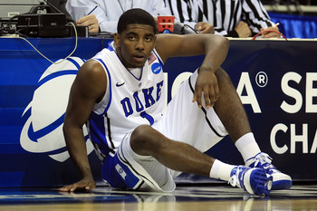 CHARLOTTE, NC - MARCH 18:  Kyrie Irving #1 of the Duke Blue Devils waits to enter the game in the first half while taking on the Duke Blue Devils during the second round of the 2011 NCAA men's basketball tournament at Time Warner Cable Arena on March 18,