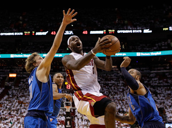 MIAMI, FL - MAY 31:  LeBron James #6 of the Miami Heat goes up for a shot between Dirk Nowitzki #41 and Tyson Chandler #6 of the Dallas Mavericks in the second half in Game One of the 2011 NBA Finals at American Airlines Arena on May 31, 2011 in Miami, Fl