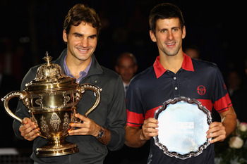 BASEL, SWITZERLAND - NOVEMBER 07:  Roger Federer of Switzerland with the winners trophy next to runner up, Novak Djokovic of Serbia after the final during Day Seven of the Davidoff Swiss Indoors Tennis at St Jakobshalle on November 7, 2010 in Basel, Switz