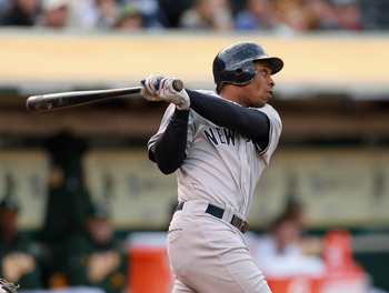 OAKLAND, CA - MAY 31:  Curtis Granderson #14 of the New York Yankees hits a two run home run in the first inning against the Oakland Athletics at Oakland-Alameda County Coliseum on May 31, 2011 in Oakland, California.  (Photo by Ezra Shaw/Getty Images)