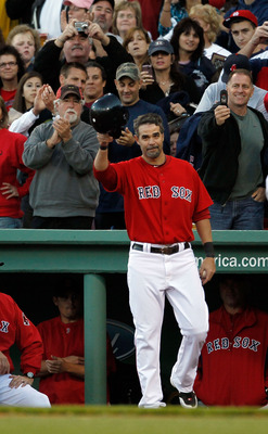 BOSTON - OCTOBER 2:  Mike Lowell #25 of the Boston Red Sox reacts to the applause after he was replaced by a pinch runner in the fifth inning during the first game of a doubleheader against the New York Yankees at Fenway Park October 2, 2010 in Boston, Ma