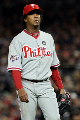 NEW YORK - NOVEMBER 04:  Pedro Martinez #45 of the Philadelphia Phillies walks back to the dugout at the end of the bottom of the second inning against the New York Yankees in Game Six of the 2009 MLB World Series at Yankee Stadium on November 4, 2009 in